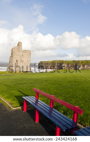 a beautiful path with benches with views of Ballybunion castle and coast - stock photo
