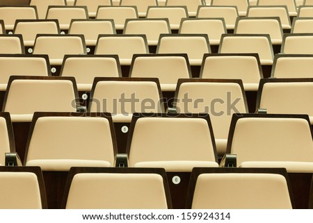 A beautiful pattern of auditorium seats built to celebrate gatherings of people, primarily for education and entertainment - stock photo