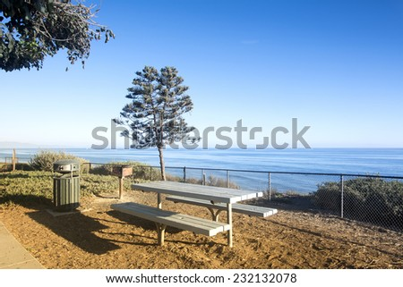 A beautiful picnic area overlooking the ocean in Santa Barbara, California at days end when the sun is setting. - stock photo
