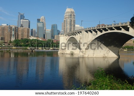 A beautiful picture of Minneapolis bridge, river and skyline - stock photo