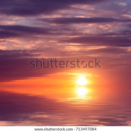 A beautiful pink sunset over the sea in the middle of summer. Sunset natural composition