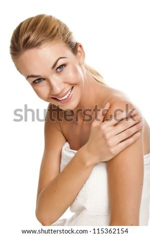 A beautiful portrait of a beautiful blond woman wearing a white towel. - stock photo