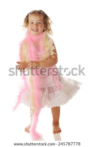 A beautiful preschool girl in boas, bracelets and a petticoat.  Isolated on white. - stock photo