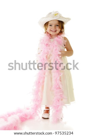 A beautiful preschooler all dressed up in white with a feathery pink boa draped around her shoulders.  On a white background. - stock photo