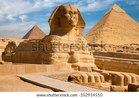 A beautiful profile of the Great Sphinx including the pyramids of Menkaure and Khafre in the background in Giza, Cairo, Egypt - stock photo