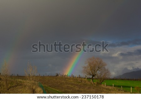 A beautiful rainbow on the rural hills