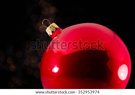 A beautiful red gift with Christmas ornaments
