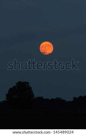 A beautiful red moon on Northern Italy - stock photo