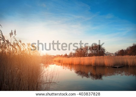 A beautiful romantic landscape at sunset on the river - stock photo