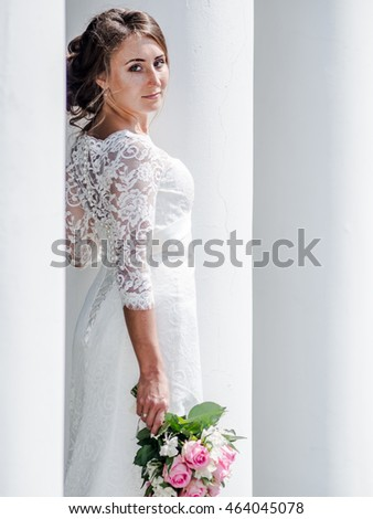 a beautiful Russian bride in a white dress on a white background