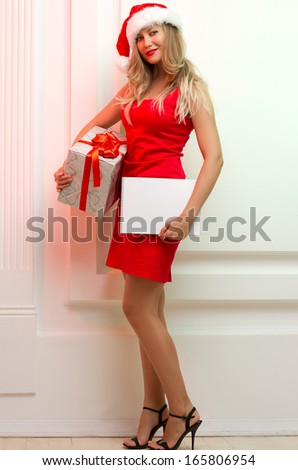 A Beautiful santa woman in red cloth with copyspace.
