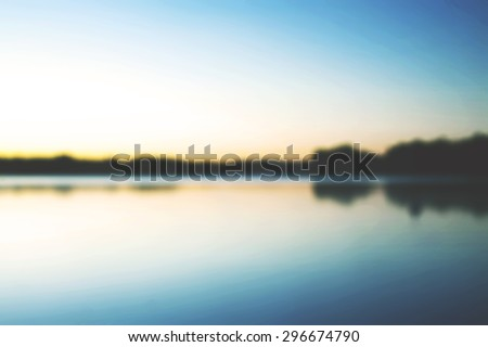 A beautiful scenery during sunset from Finland in a blurry mode. Image has a field blur applied. This images suits perfectly as a background for text, website or anything else - stock photo