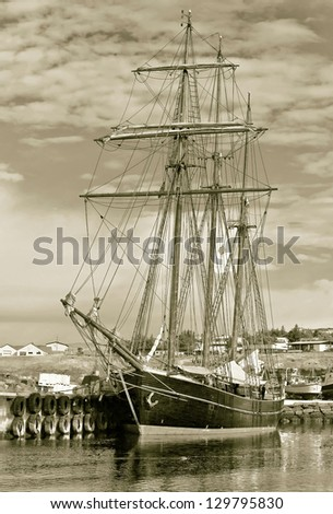 A beautiful schooner in the port of Reykjavik city, Iceland (stylized retro) - stock photo