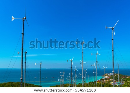 A beautiful seascape image with Windturbine farm with blue sky at Koh Lan Pattaya Thailand
