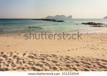 a beautiful seascape shot on a tropical beach in Phi Phi Island, Thailand, in the Andaman sea, at sunset or sunrise - stock photo