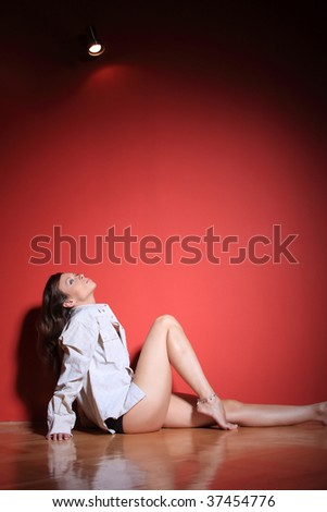 A beautiful sexy women  on  red background - stock photo