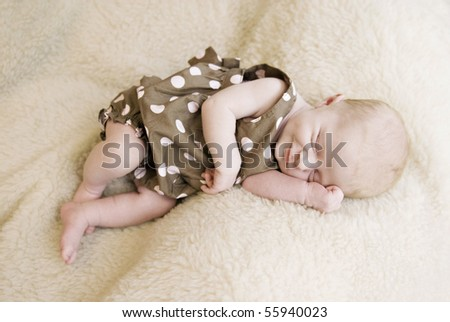 A beautiful sleeping three week old baby girl with soft focus - stock photo
