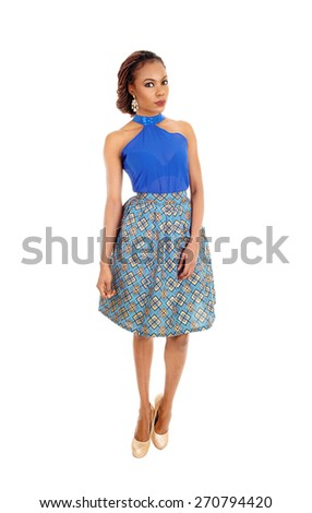 A beautiful slim African American woman standing in a lovely skirt and blue blouse isolated for white background.  - stock photo