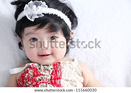 A beautiful smiling asian baby - stock photo