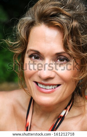 A Beautiful Smiling Mature Woman Outdoors - stock photo