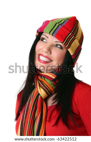 A beautiful smiling woman wearing vibrant happy colours.  She is looking sideways.  Suitable for copy.  White background.
