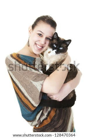 A beautiful Snowshoe Lynx Point Siamese cat being hugged by her female owner.  Shot on white background. - stock photo