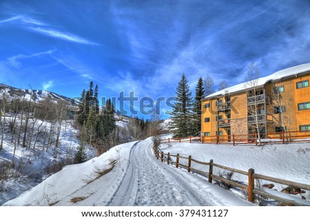 A beautiful snowy path in the Rockies Mountains in Snowmass near Aspen, Colorado on a beautiful day