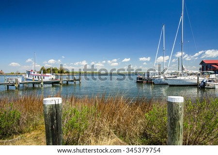 A Beautiful Spring Day View across the harbor at St. Michael's Chesapeake Bay Maritime Museum in Maryland. - stock photo