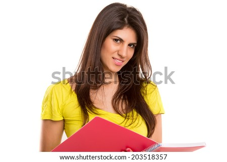 A beautiful student posing isolated over a white background
