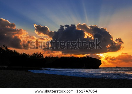 A beautiful sunrise greets the day in Kauai - stock photo