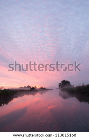 A beautiful sunrise in the Netherlands with autumn fog