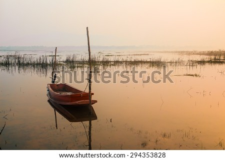 A beautiful sunrise seen the fishing boat - stock photo