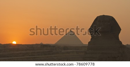 A beautiful sunset at the Sphinx and the Pyramids in Giza, Egypt - stock photo