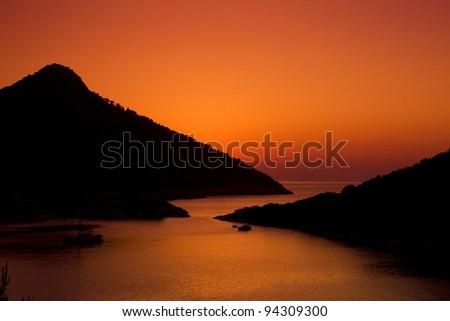 A beautiful sunset on bay. Island in Croatia during summer. - stock photo