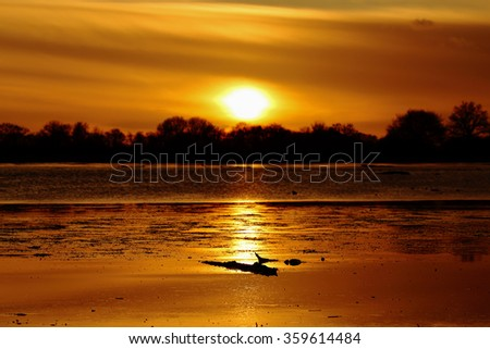 A beautiful sunset on the lake - stock photo