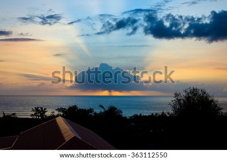 A beautiful sunset on the westcoast of Reunion Island in the Indian Ocean - stock photo