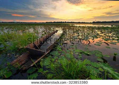 A beautiful Sunset seen the fishing boat - stock photo
