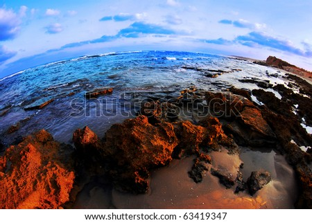 a beautiful sunset taken with a fish eye lens. - stock photo