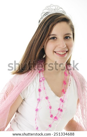 A beautiful teen girl happily wearing a crown, lacey pink shawl and a silver crown.  On a white background. - stock photo