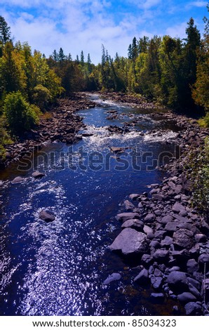 A beautiful view of Opishing River in Northern Ontario - stock photo