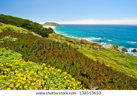 A Beautiful View of the California Coastline along State Road 1, with Point Sur Historic Park in the background. - stock photo