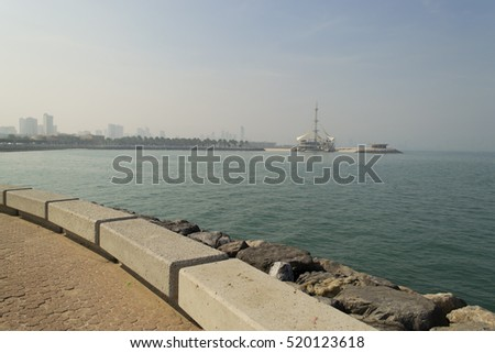 A beautiful view with  the Marina Waves Pavilion, in light of sunset in Kuwait City