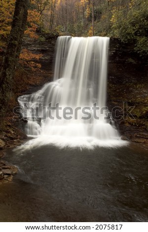 A  beautiful  waterfall deep in the forests of Virginia. Fall colors along the stream add to the beauty of the scene. - stock photo