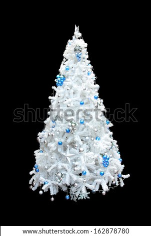 A beautiful white artificial christmas tree with blue and silver spheres. Isolated on a black background - stock photo
