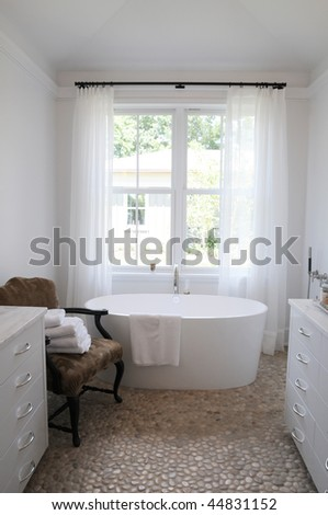 A beautiful white bathroom with stone floor - stock photo