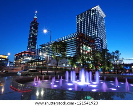 a beautiful winter day over the taipei 101 with blue sky in the evening - stock photo