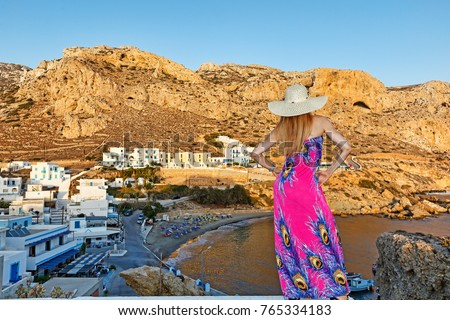 A beautiful woman above the village Finiki of Karpathos, Greece