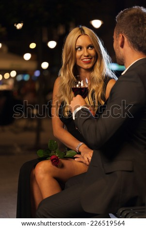 A beautiful woman and elegant man celebrating his proposal - stock photo