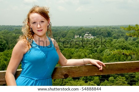 A beautiful woman at a mountain overlook - stock photo