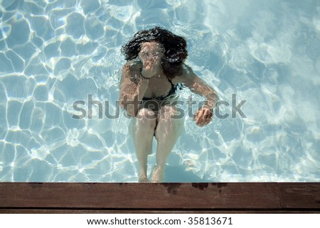 a beautiful woman diving in a swimming pool